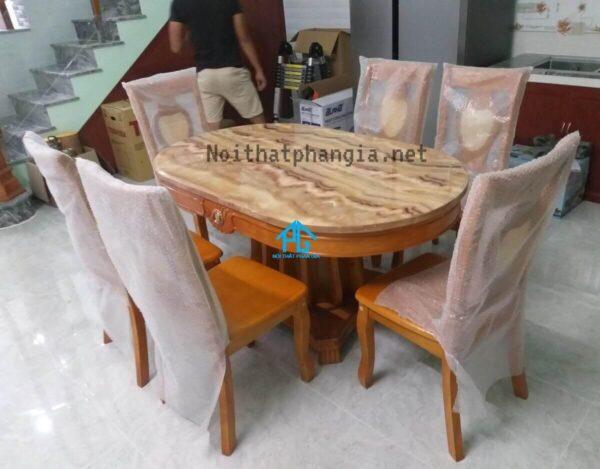 bàn ăn 6 ghế nhập khẩu mặt đá oval 565