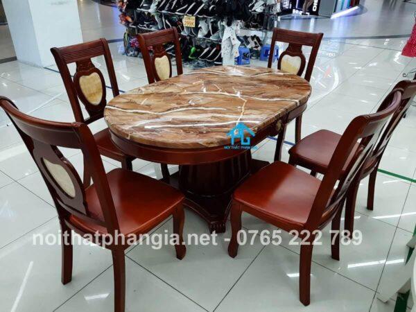 bàn ăn nhập khẩu oval 565